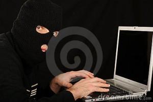 masked man at computer